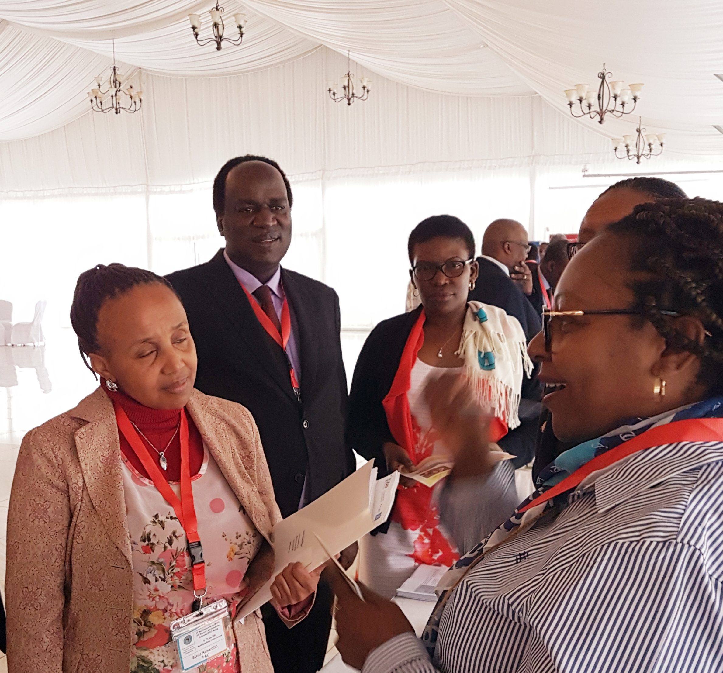 Dr. David Okello and Dr. Elsie Kiguli Malwadde chatting with participants at the ECSA Forum