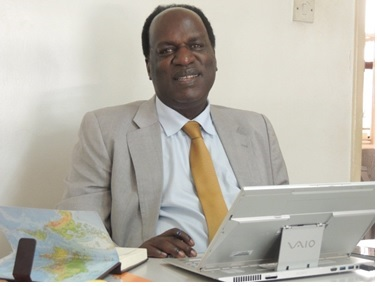 Dr. David. O Okello at the African Centre for Global Health and Social Transformation ACHEST offices