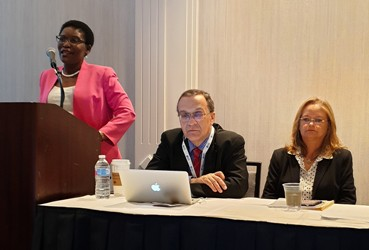 Dr.Elsie presenting at the CUGH conference