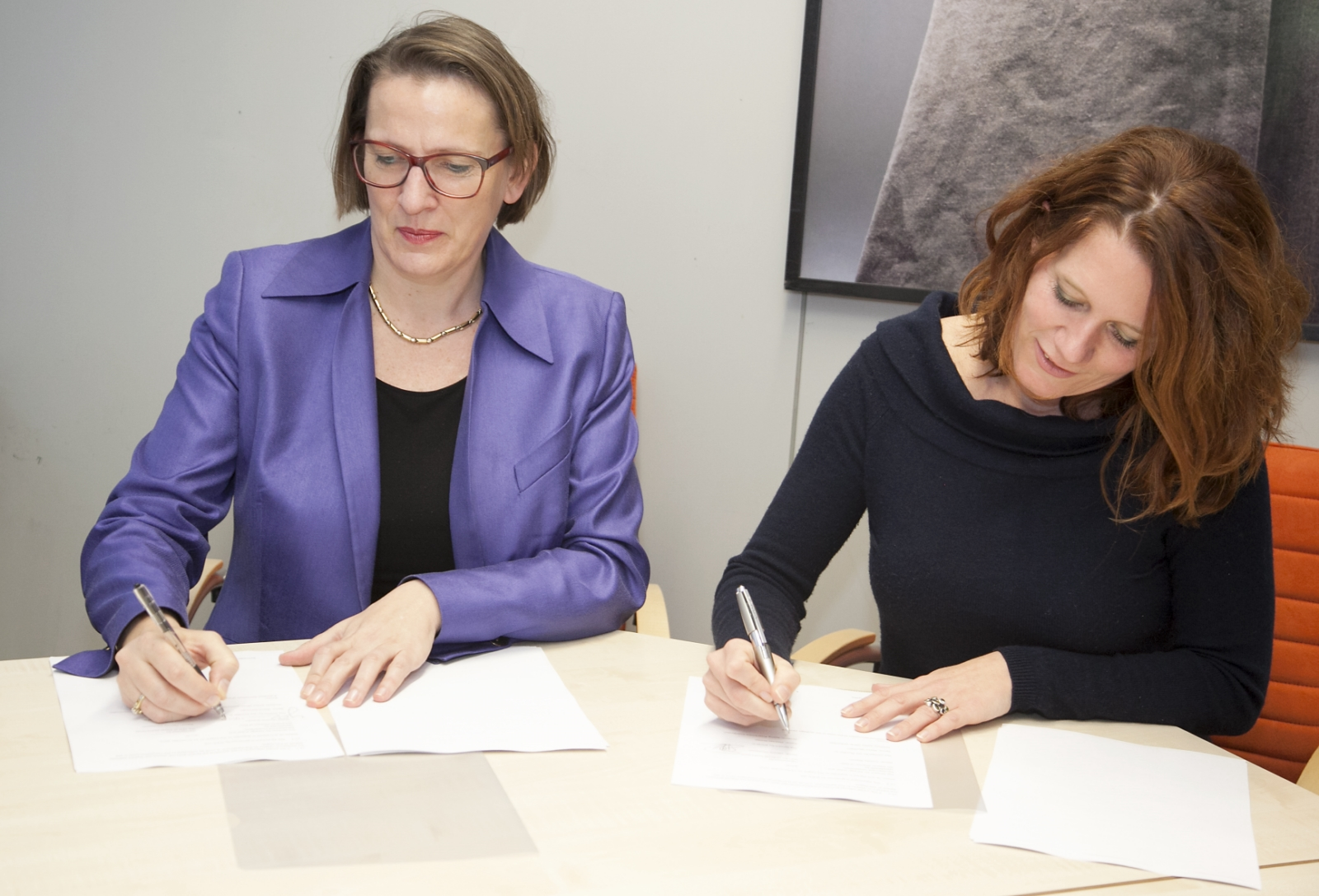 Members sign the Partnership Agreement