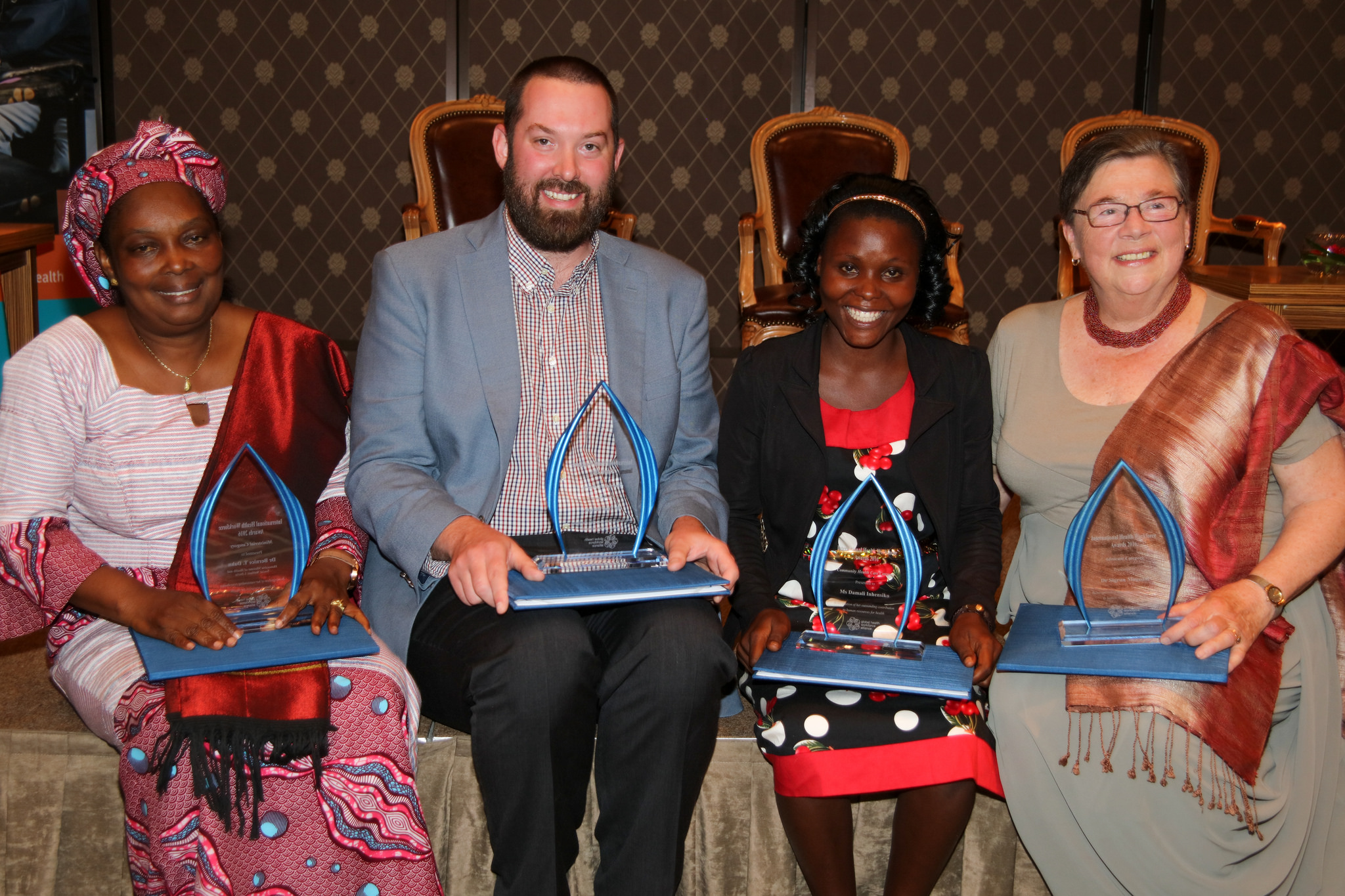 Ms. Damalie Inhensiko and the other winners of the award at the celebration event in Geneva