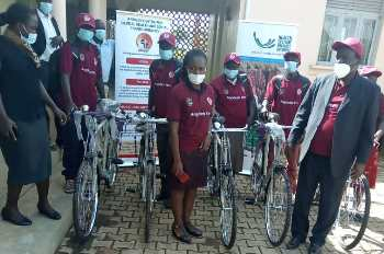 The Village Health Team receive bicyles and other tools to use during the course of the project
