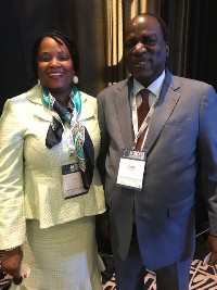 Dr. David Okello posing with Dr. Margaret Agama-Anyetei  Head of Division Health Nutrition and Population Department AU Social Affairs1