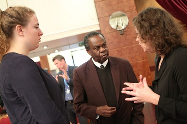 Prof. Francis Omaswa (in the middle) speaking to some of the participants during the meeting in Geneva.